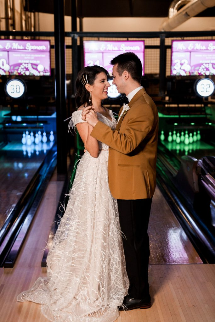 Wedding couple in front of duckpin lanes