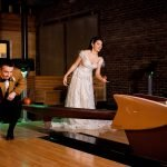 bride and groom bowling on duckpin lanes